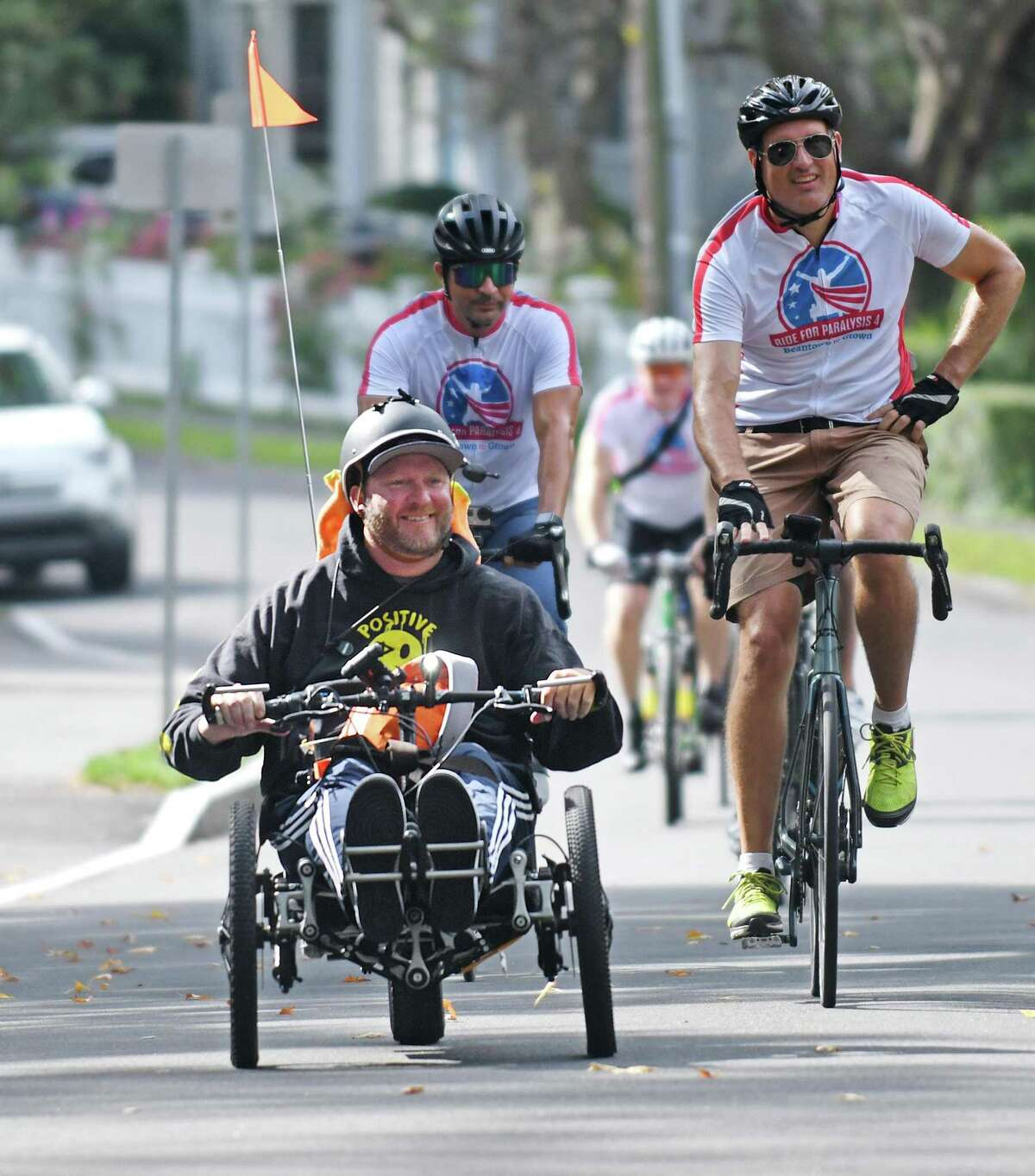 """Brunswick alumnus Janne Kouri passes by in his electric bike as part of his tour """"Ride for Paralysis 4: Beantown to Gtown"""" at Brunswick School in Greenwich, Conn. Wednesday, Sept. 22, 2021. Kouri is in the middle of a 520 mile, 12 day ride from Boston to Washington, D.C. to raise money and awareness for the 6 million individuals and wounded service members living with paralysis in the U.S."""