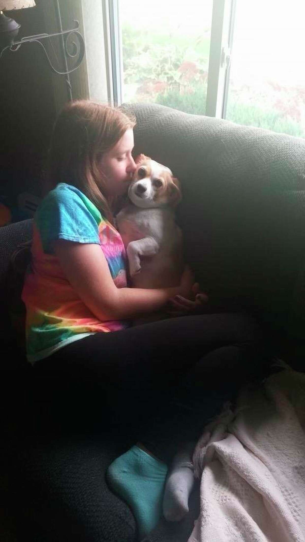 Kaitlyn Dill, 21 of Freeland is facing-down leukemia for the third time since she was 5 years old. She said her dog, Rylee, is one of the faces that helps her get through each day, along with the many supporters. A family friend started a GofundMe page for Dill. (Photo provided)