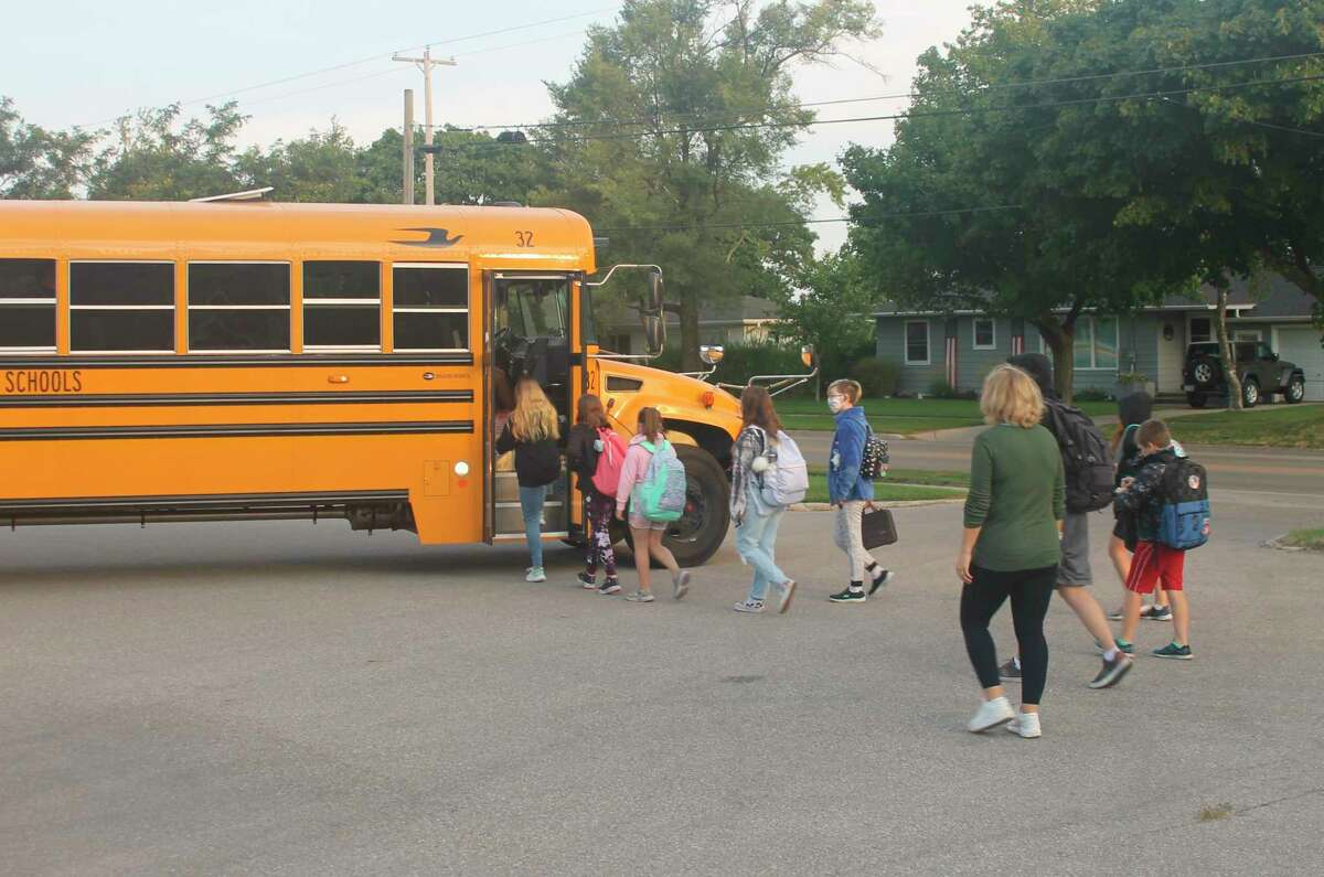 Armory Youth Project assistant executive director Theresa Anderson sees students to the school bus at the Armory parking lot on Monday.Manistee Area Public Schools starts an hour later on Mondays so the Armory opens its doors at 7:30 a.m. to provide families a place to drop their students off if they have to go to work. (Kyle Kotecki/News Advocate)