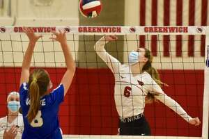 Greenwich's Adele Sotgiu (6) takes a shot as Darien's Aubrey Moore (8) defends during the FCIAC West Region volleyball final in Greenwich on Wednesday, Nov. 11, 2020.
