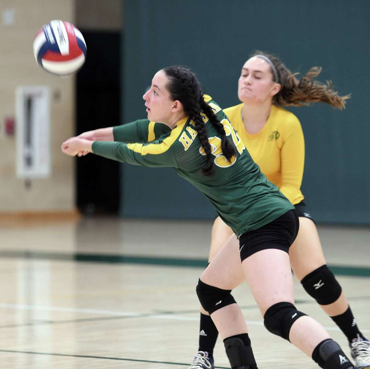 Maile Estacion of Hamden hits the ball in a volleyball match against Foran on September 23, 2019.