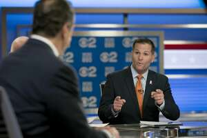 New York Gov. Andrew Cuomo, left, and Republican gubernatorial candidate Marc Molinaro, right, argue during the New York gubernatorial debate in 2018.