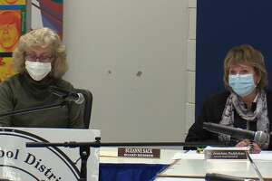 Board Chair Suzanne Sack and Superintendent JeanAnne Paddyfote speak during a Tuesday, Sept. 21, 2021 Regional School District 17 Board of Education meeting.