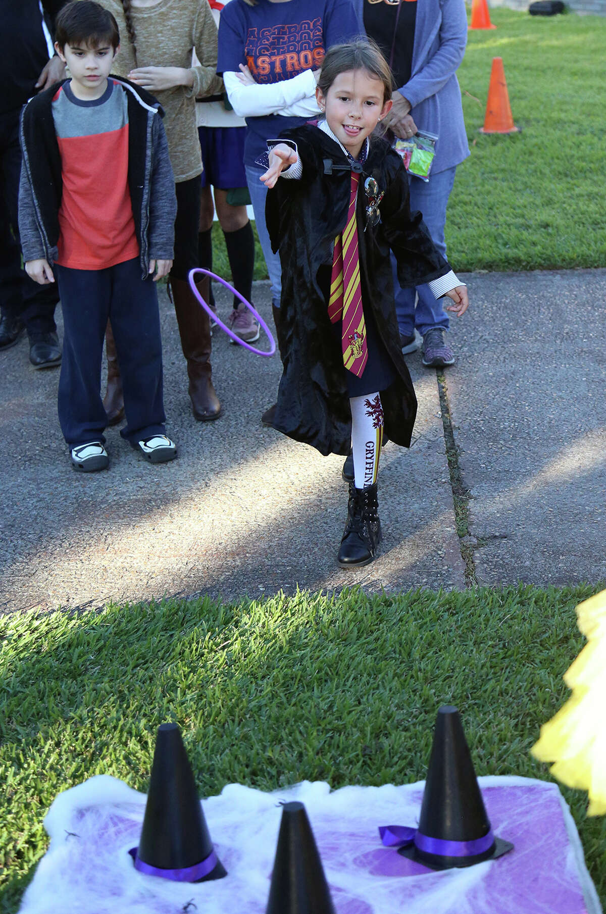 Children play a bewitching version of ring toss during Alvin Community College's 2019 Fall Festival. Vendor booths remain available for this year's event, Oct. 30.
