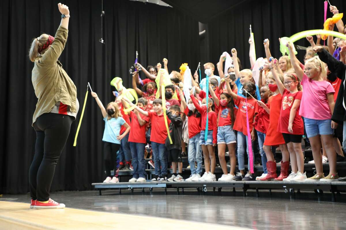 The EC Mason Elementary School choir sings at the dedication of the new campus for the Alvin ISD school.
