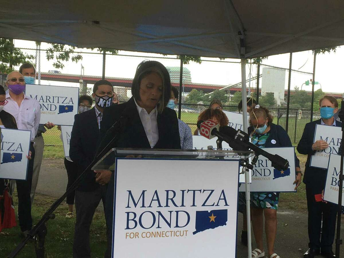 New Haven Health Director Maritza Bond announces plans to explore a run for Secretary of State, speaking in Fair Haven's Criscuolo Park, surrounded by family and friends.