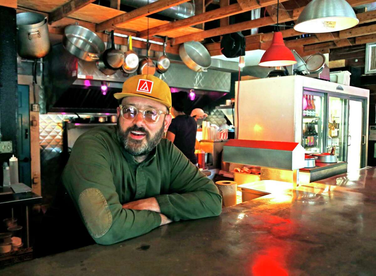 Owner Chris Cullum poses inside his Attagirl establishment, which sits just a few steps from a new property he acquired that will be Cullum's Attaboy restaurant at a later date.