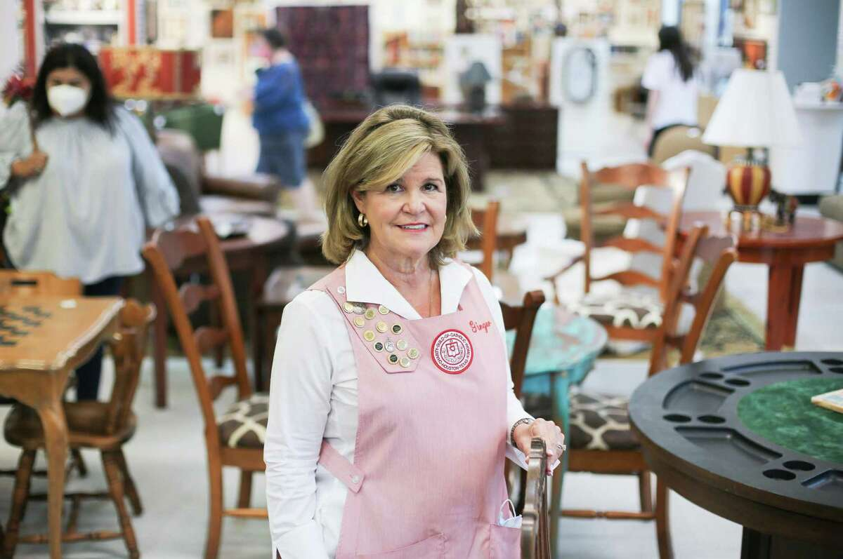 Charity Guild of Catholic Women President Ginger Niemann in the guild's thrift shop in Houston on Wednesday, Sept. 1, 2021. The organization is celebrating 100 years in October.
