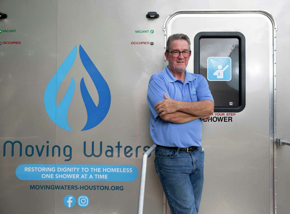 Jimmy Patterson, 62, poses for a photograph with a Moving Waters of Houston's mobile shower trailer Saturday, Sept. 4, 2021, at Tomball United Methodist Church in Tomball. Patterson, a board member of Moving Water of Houston, and the organization provides mobile showers for the homeless in the Houston area.