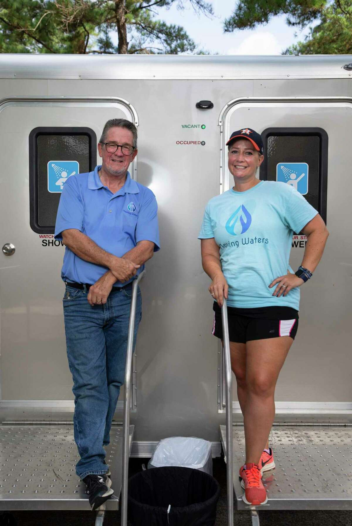 Jimmy Patterson, 62, and daughter Jennifer Park, 35, pose for a photograph with a Moving Waters of Houston's mobile shower trailer Saturday, Sept. 4, 2021, at Tomball United Methodist Church in Tomball. Park is the founder and executive director of Moving Waters of Houston while Patterson is a board member. The organization provides mobile showers for the homeless in the Houston area.