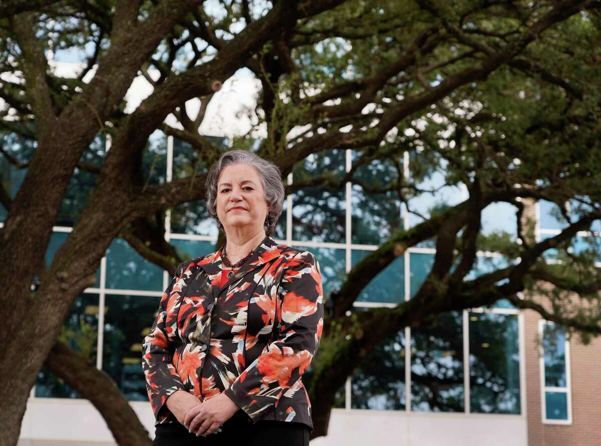 Katy Caldwell, CEO of Legacy Community Health, advocated to keep the trees outside the center. She will be retiring after 25 years.