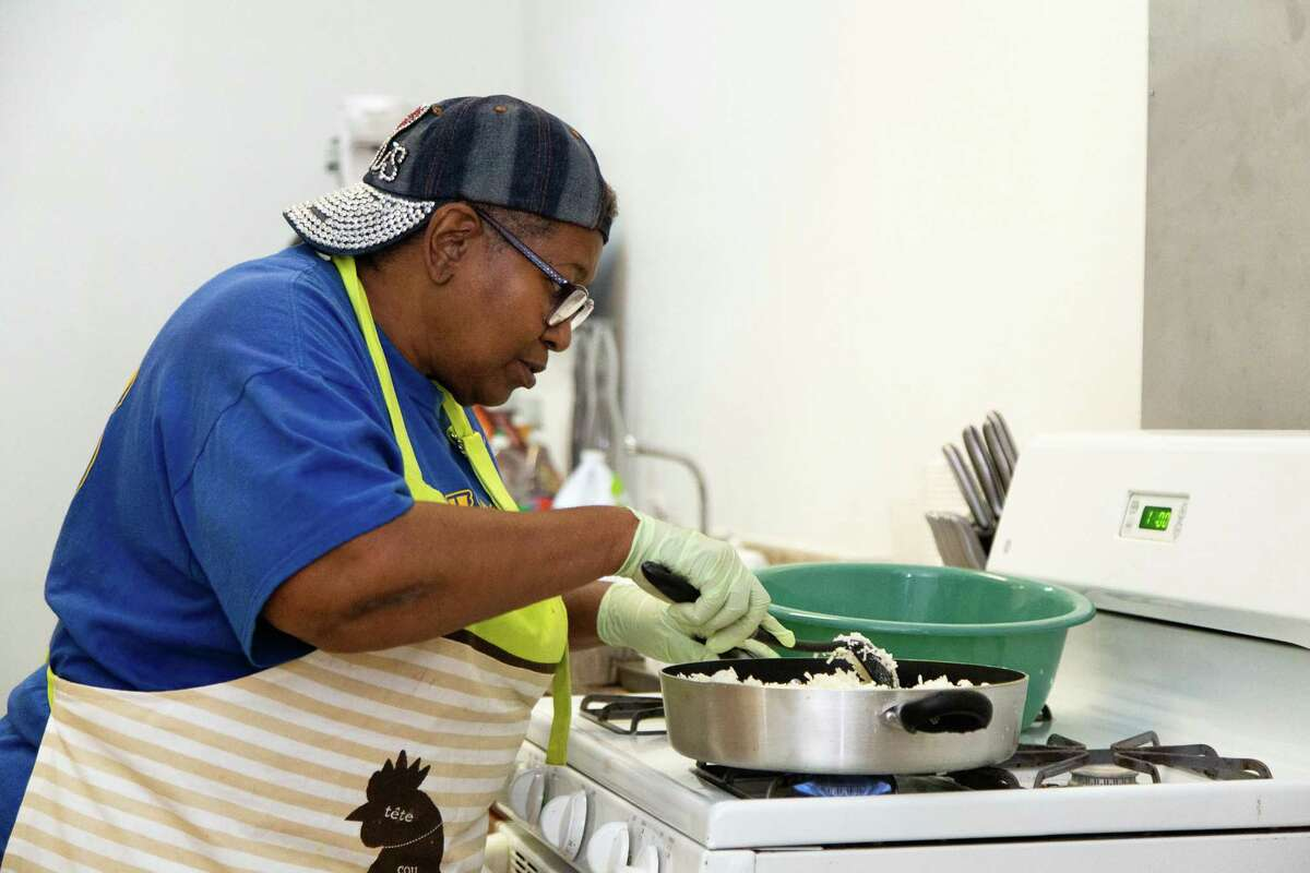 Agnes Scott Taylor cooks up meals to deliver to the homeless and those in need.