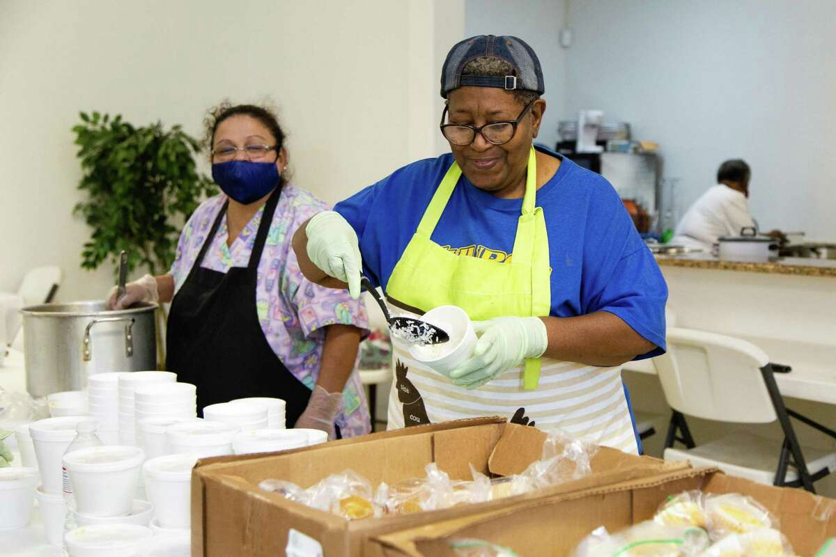 Henrietta Palacios, left, and Agnes Scott Taylor cook up meals to deliver to the homeless and those in need.