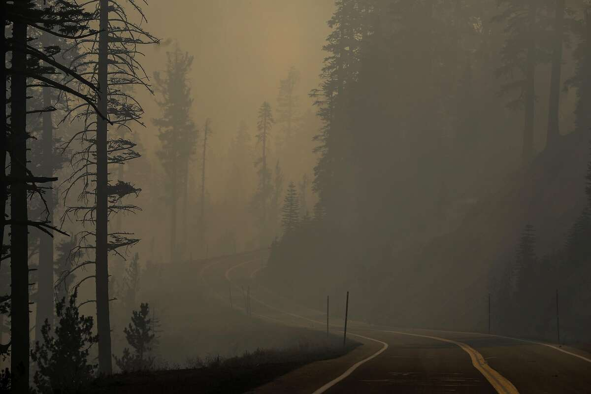 Smoke from the Caldor Fire can be seen on Highway 88 on Sept. 1. The thick wildfire smoke has compromised wine grapes grown in the area.