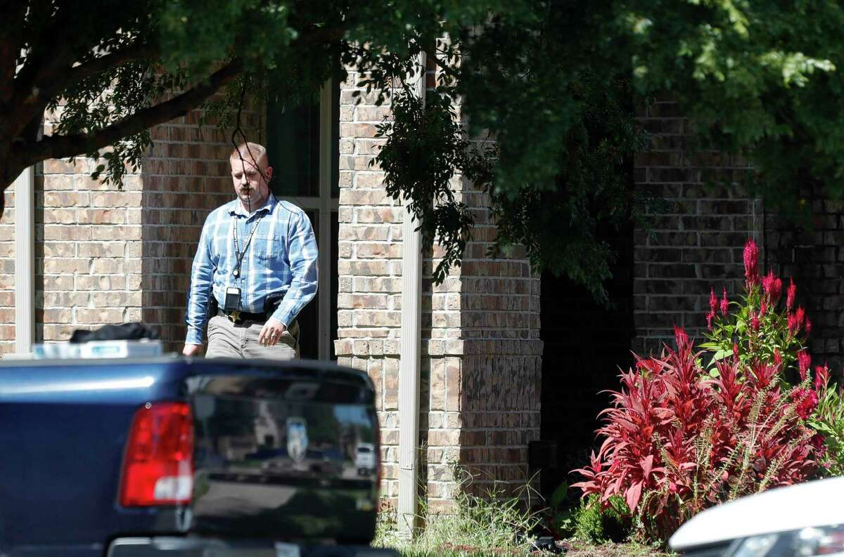 Officers with the Montgomery County Sheriff's Office work the scene of a home in the King's Mill subdivision in Kingwood in connection to Monday's shooting of a 14-year-old Porter High School student, Wednesday, Sept. 22, 2021, in Kingwood.