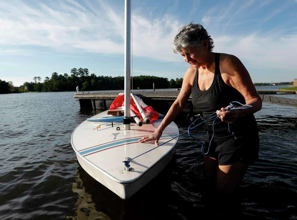 """Karen Fearon prepares her sailboat after getting it on Lake Woodlands for a morning of sailing on the first day of fall, Wednesday, Sept. 22, 2021, in The Woodlands. """"As soon as I saw the weather, I couldn't wait to loaded up my boat last night,"""" Fearon said. """"Usually you either get good wind or good weather, but with this 70-degree morning we've got both. Today is just perfect.""""The first cool front move through the region Tuesday evening and fall conditions are expected to continue into the weekend with highs in the low-80s and lows in the 50s."""