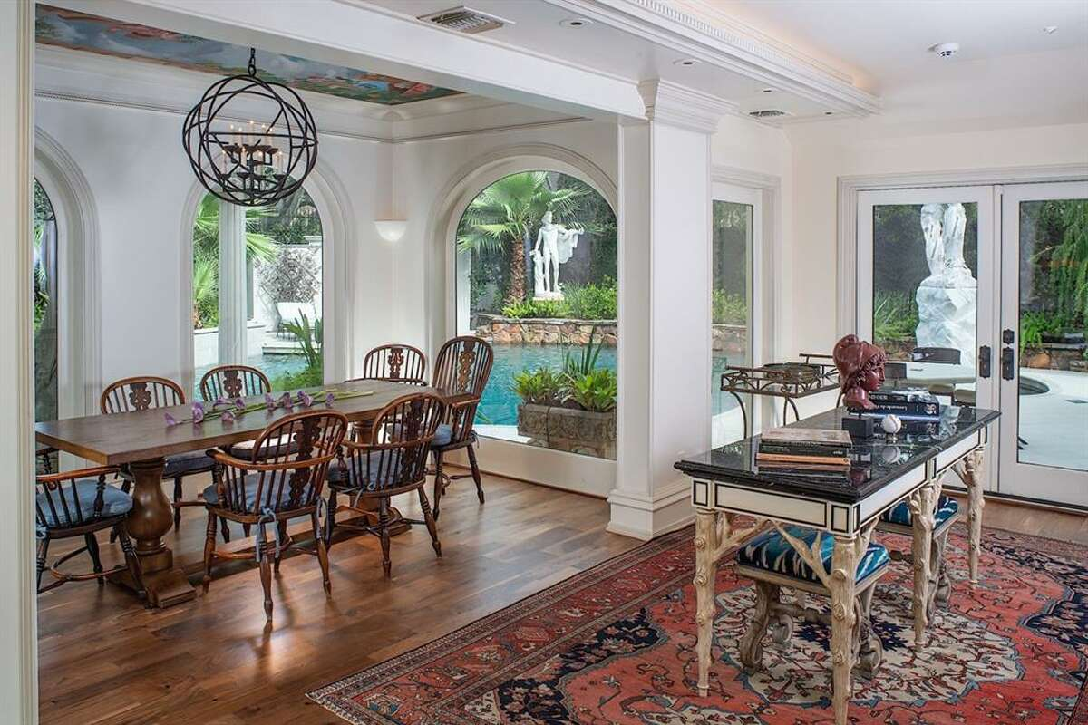 A historic remodeled Roman villa just hit the market in the Edgemont district for $6.5 million. Pictured is the new dining area with a much lighter decor.