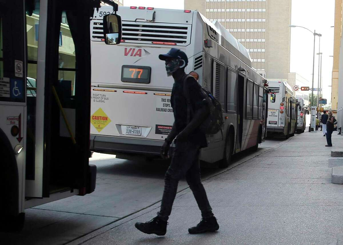 A bus rider boards downtown in June, as VIA buses and vans returned to full capacity from pandemic-imposed occupancy limits.