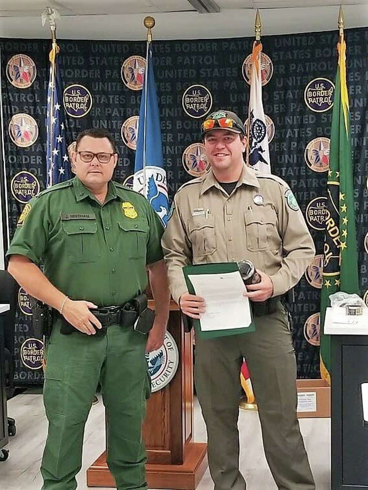 Justin Needham, Deputy Patrol Agent in Charge of the Laredo North Station, recognized Texas Parks and Wildlife Game Warden Keegan Moore for his assistance in a recent incident that led to the arrest of a suspect.