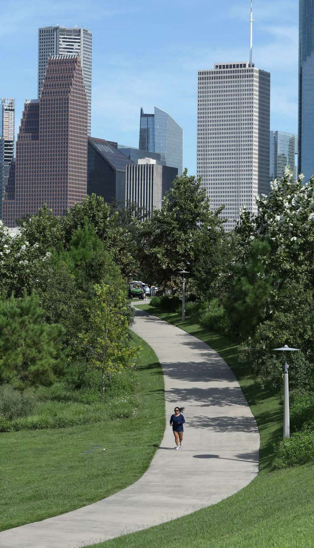 A woman jogs on a path in Eleanor Tinsley Park near Buffalo Bayou, Wednesday, September 22, 2021, in Houston.
