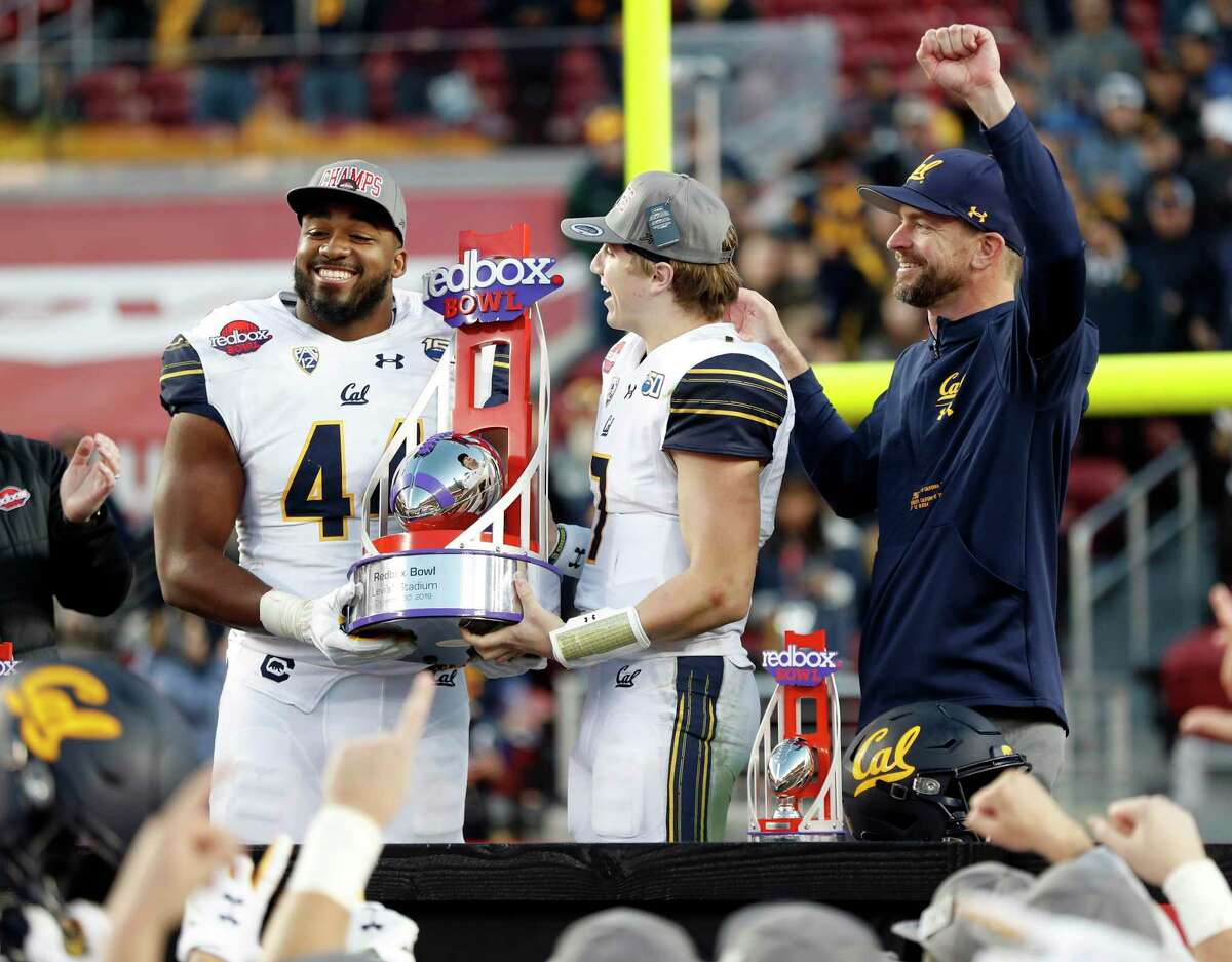 California's Zeandae Johnson, Chase Garbers and head coach Justin Wilcox celebrate Cal's 35-20 win over Illinois in Redbox Bowl at Levi's Stadium in Santa Clara, Calif., on Monday, December 30, 2019.