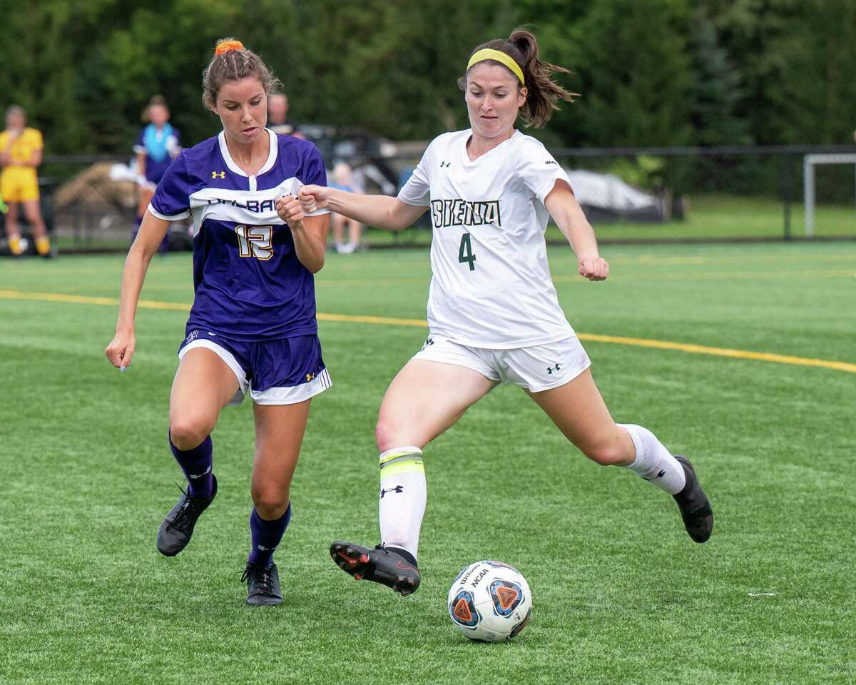 Siena midfielder Emily McNelis gets a foot on the ball in front of UAlbany midfielder Iola Cotter at Siena College in Loudonville, NY, on Wednesday, Sept. 22, 2021. (Jim Franco/Special to the Times Union)