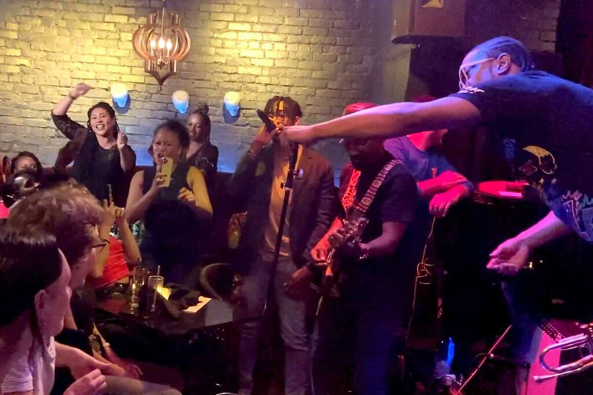Raphael Saadiq and D'Wayne Wiggins of Tony! Toni! Toné! surprise fans at the Black Cat in San Francisco on Sept. 15. San Francisco Mayor London Breed (top left) was in attendance.