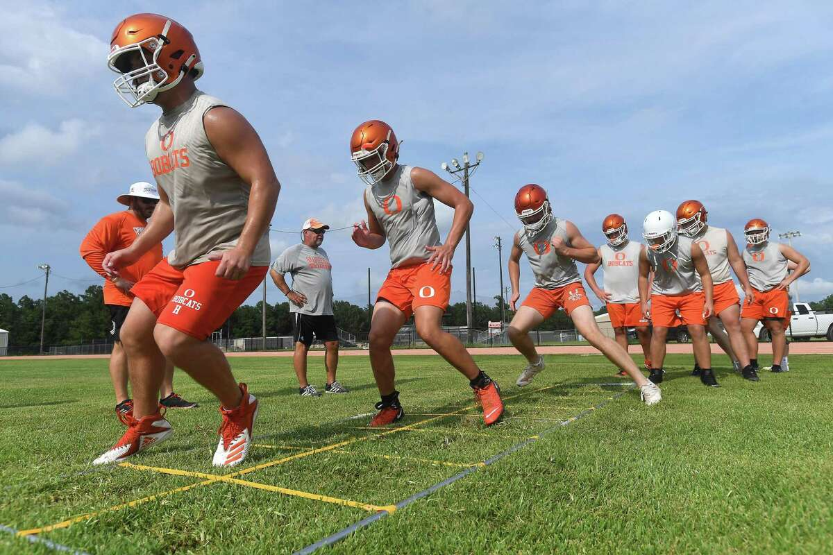 Orangefield gets in evening practice as they prep for the start of the 2021 football season. Photo made Tuesday, August 3, 2021 Kim Brent/The Enterprise