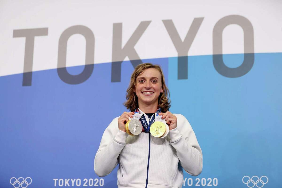 The United States' Katie Ledecky displays her two Gold and two Silver medals after a news conference during the Tokyo Olympic Games on Saturday, July 31, 2021, in Tokyo.