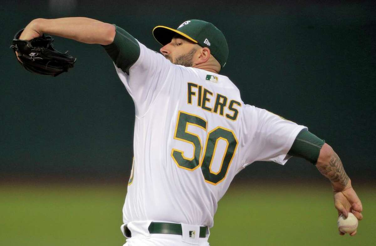Mike Fiers (50) pitches in the first inning as the Oakland Athletics played the Texas Rangers at the Coliseum in Oakland, Calif., on Monday, August 20, 2018.
