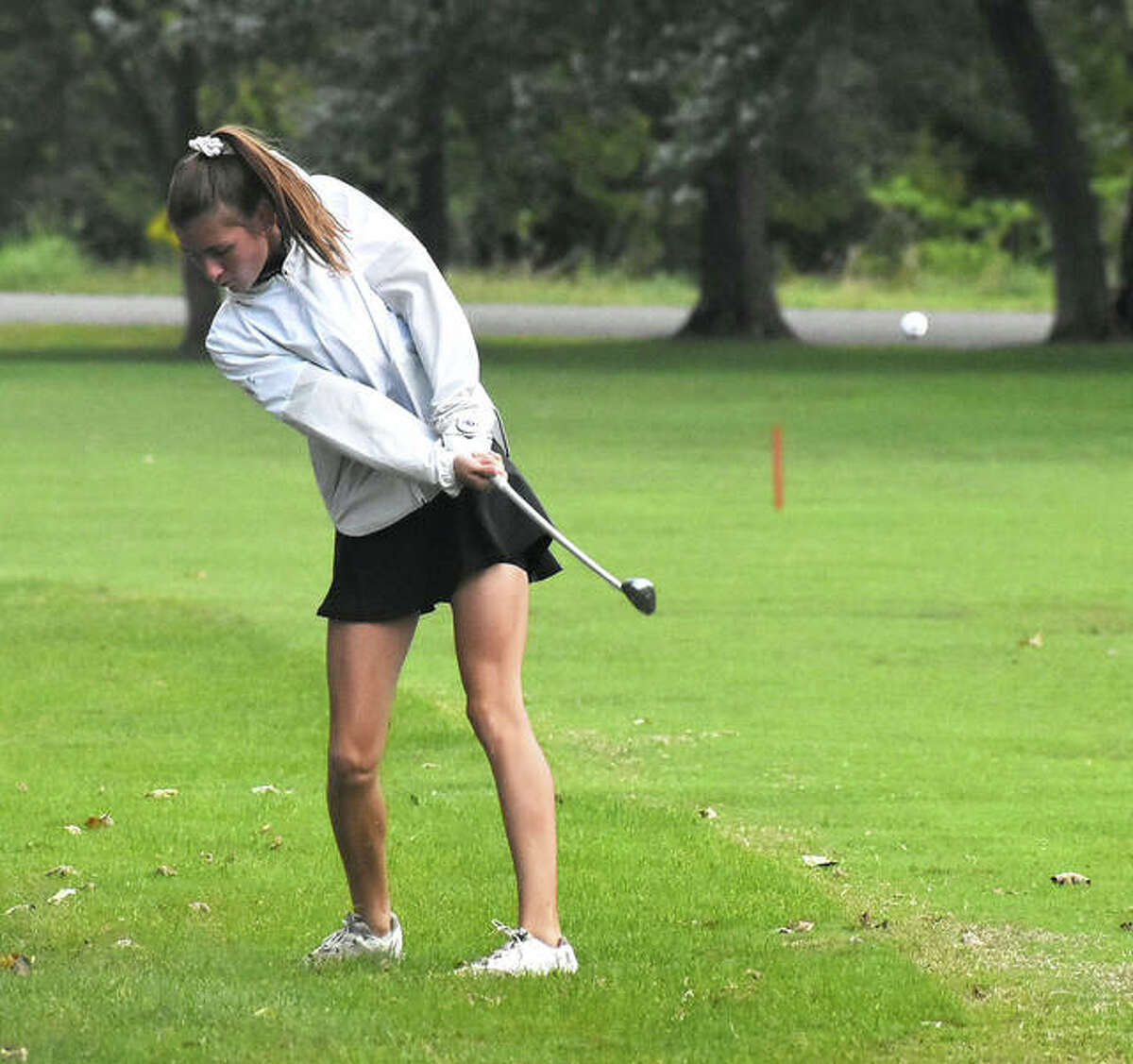 Edwardsville's Emilie Fry hits her third shot on No. 1 at Oak Brook Golf Club during a triangular with Marquette and Triad on Wednesday in Edwardsville.