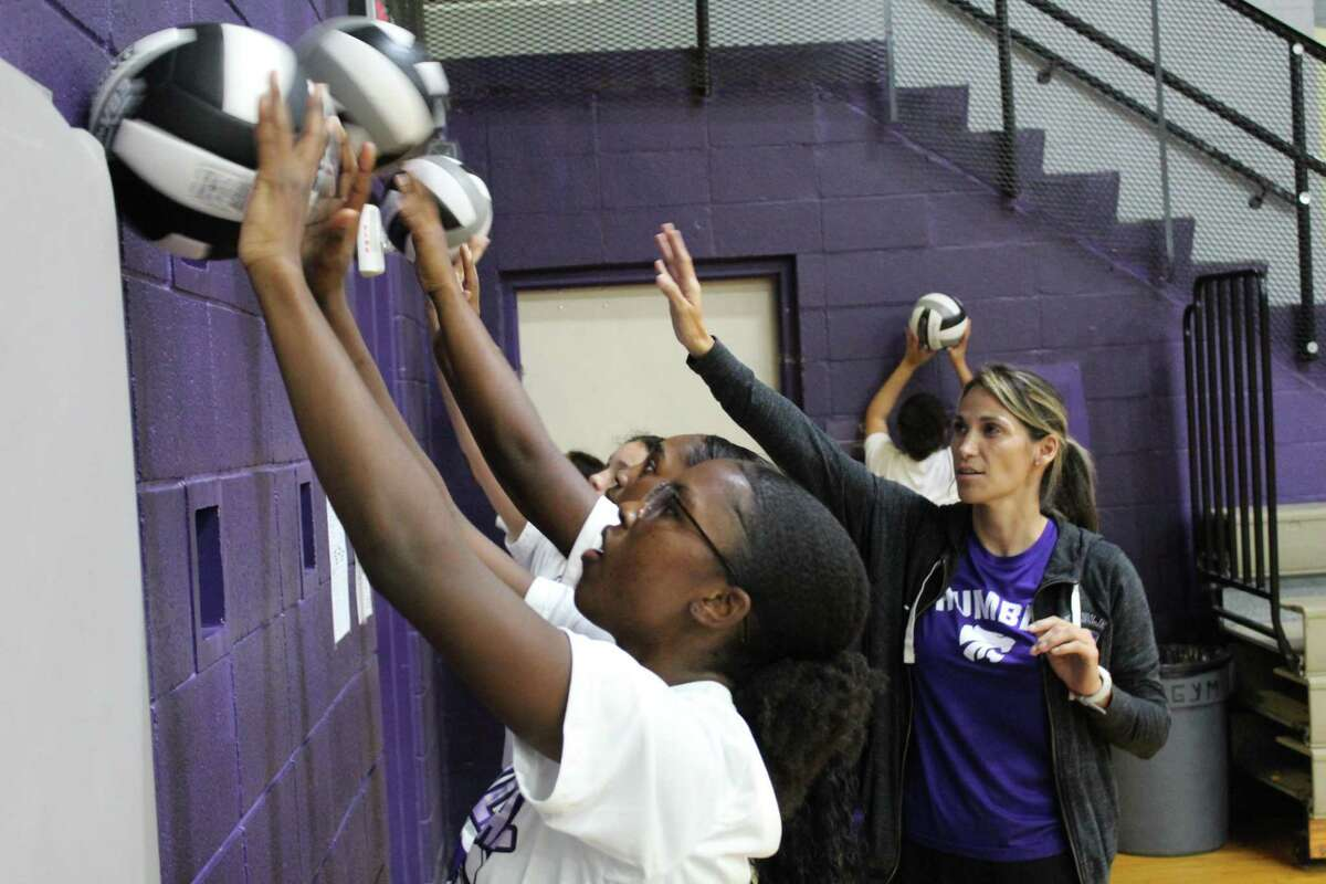Humble head coach Michelle Funderburk working with the Lady Wildcats during practice.