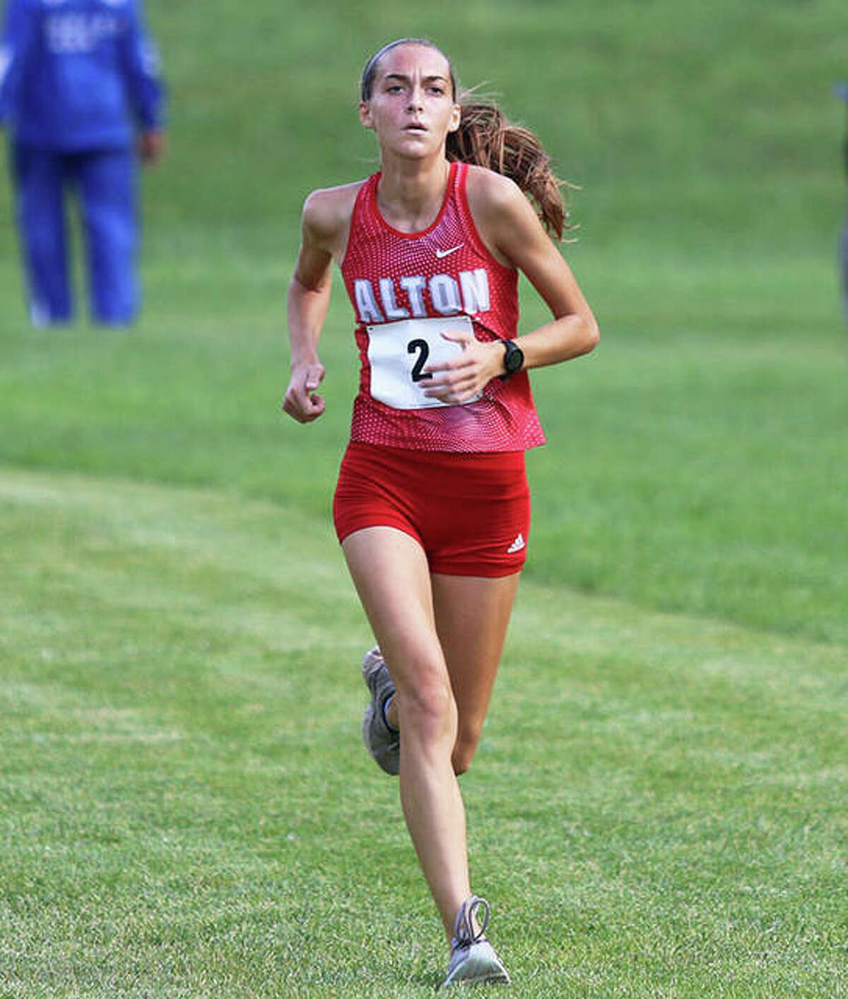 Alton's Sophie Paschal approaches the finish line in second place Wednesday in the Alton Invite. It was the first race run on the new course behind Alton High.
