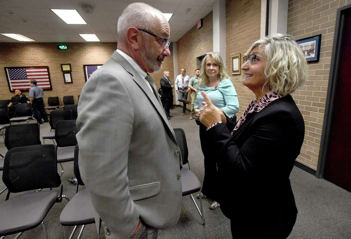 """Beaumont Police Chief James Singletary talks with and thanks Shera LaPoint - aka """"The Gene Hunter"""" - following a press conference at Beaumont Police headquarters to provide an update on the indictment of Clayton Bernard Foreman, who is being charged with capital murder in the 1995 assault and killing of Mary Catherine Edwards. The case was finally solved using DNA geneaology technology with the aid of LaPoint. Photo made Wednesday, September 22, 2021 Kim Brent/The Enterprise"""