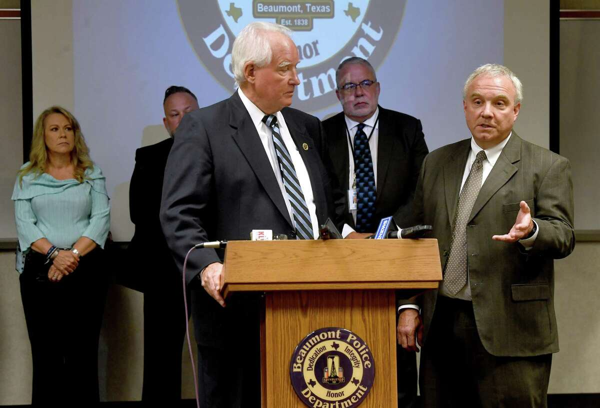 """District Attorney Bob Wortham listens First Assistant Pat Knauth addresses a question regarding the death penalty as during a press conference at Beaumont Police headquarters to provide an update on the indictment of Clayton Bernard Foreman, who is being charged with capital murder in the 1995 assault and killing of Mary Catherine Edwards. The case was finally solved using DNA geneaology technology with the aid of """"The Gene Hunter"""" Shera LaPoint. Photo made Wednesday, September 22, 2021 Kim Brent/The Enterprise"""
