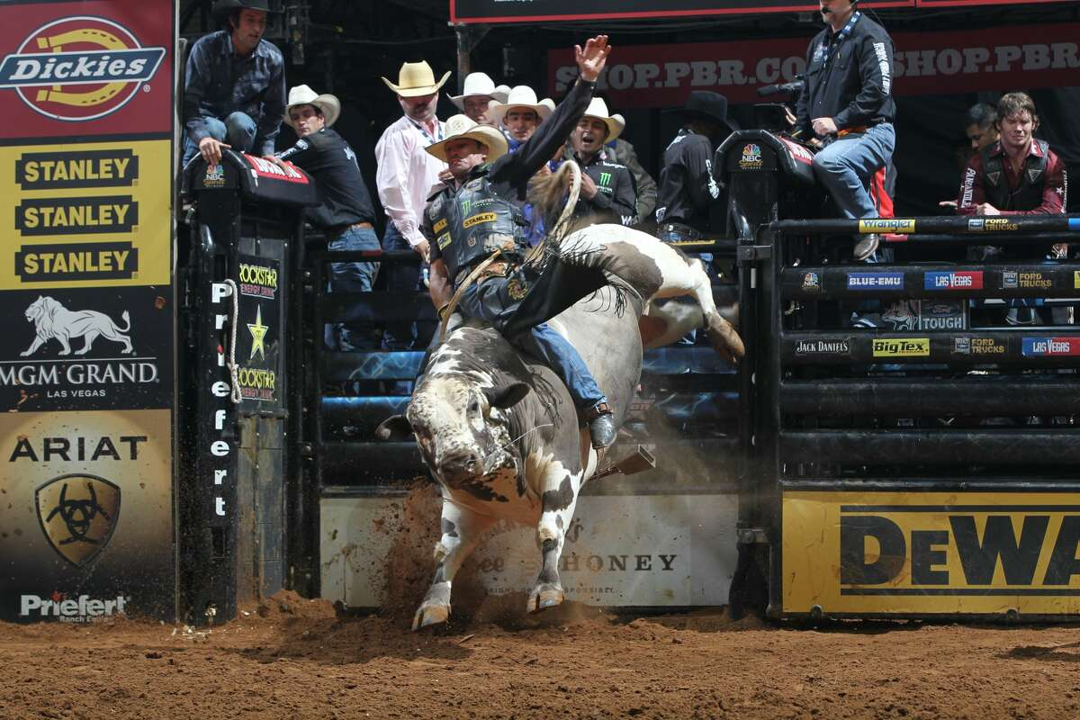 Guilherme Marchi attempts to ride Robinson's Wild Nights during the second round of the San Antonio Built Ford Tough series PBR in 2012.