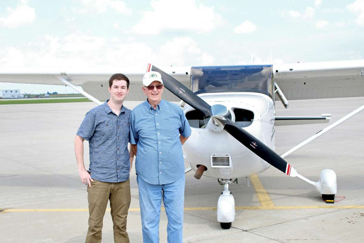 Sean and Kenneth Sperry pose next to the Cessna 172S Skyhawk they are about to take to the sky.