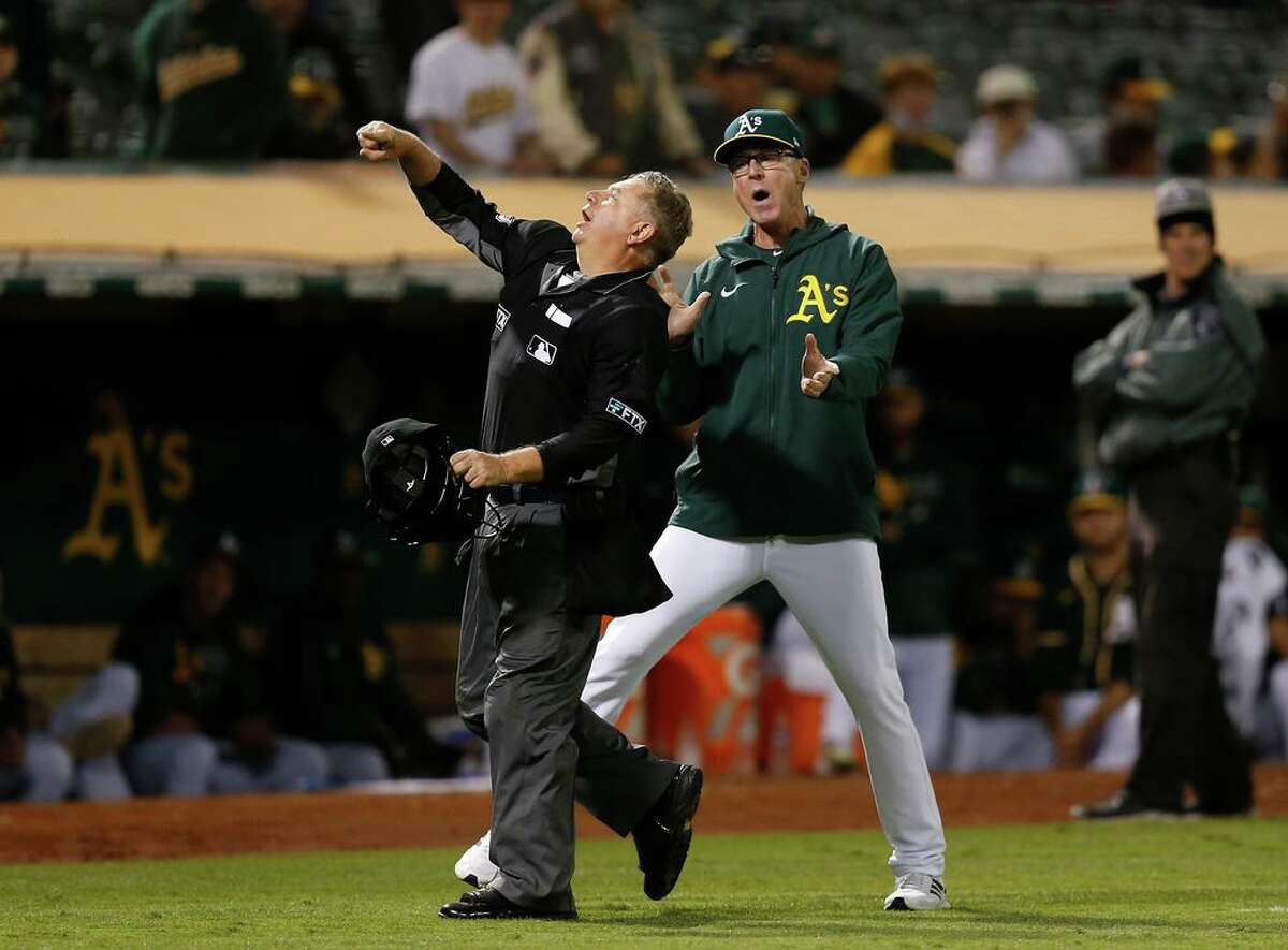 OAKLAND, CALIFORNIA - SEPTEMBER 22: Manager Bob Melvin #6 of the Oakland Athletics is ejected from the game by home plate umpire Greg Gibson #53 in the top of the fifth inning against the Seattle Mariners at RingCentral Coliseum on September 22, 2021 in Oakland, California. (Photo by Lachlan Cunningham/Getty Images)