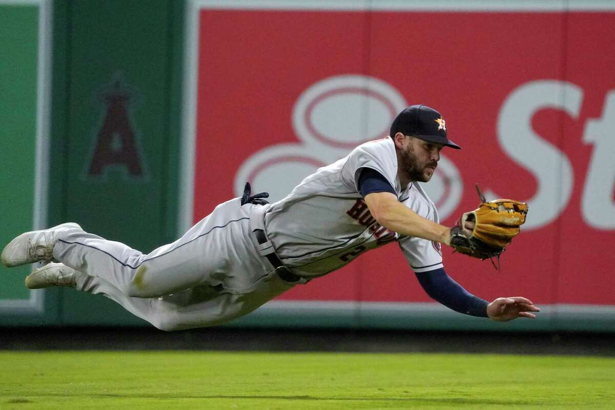 Chas McCormick's diving catch helped keep a bad seventh inning from getting worse for the Astros, who rallied to force extra innings and win in the 12th on Wednesday night in Anaheim.