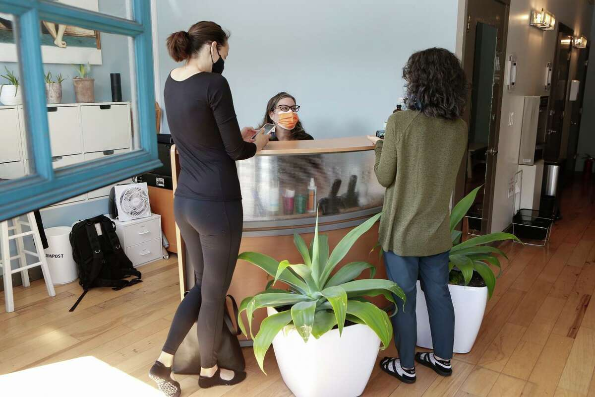 Tracey Sylvester, the owner of EHS Pilates Studio in San Francisco, converses with students between classes in May.