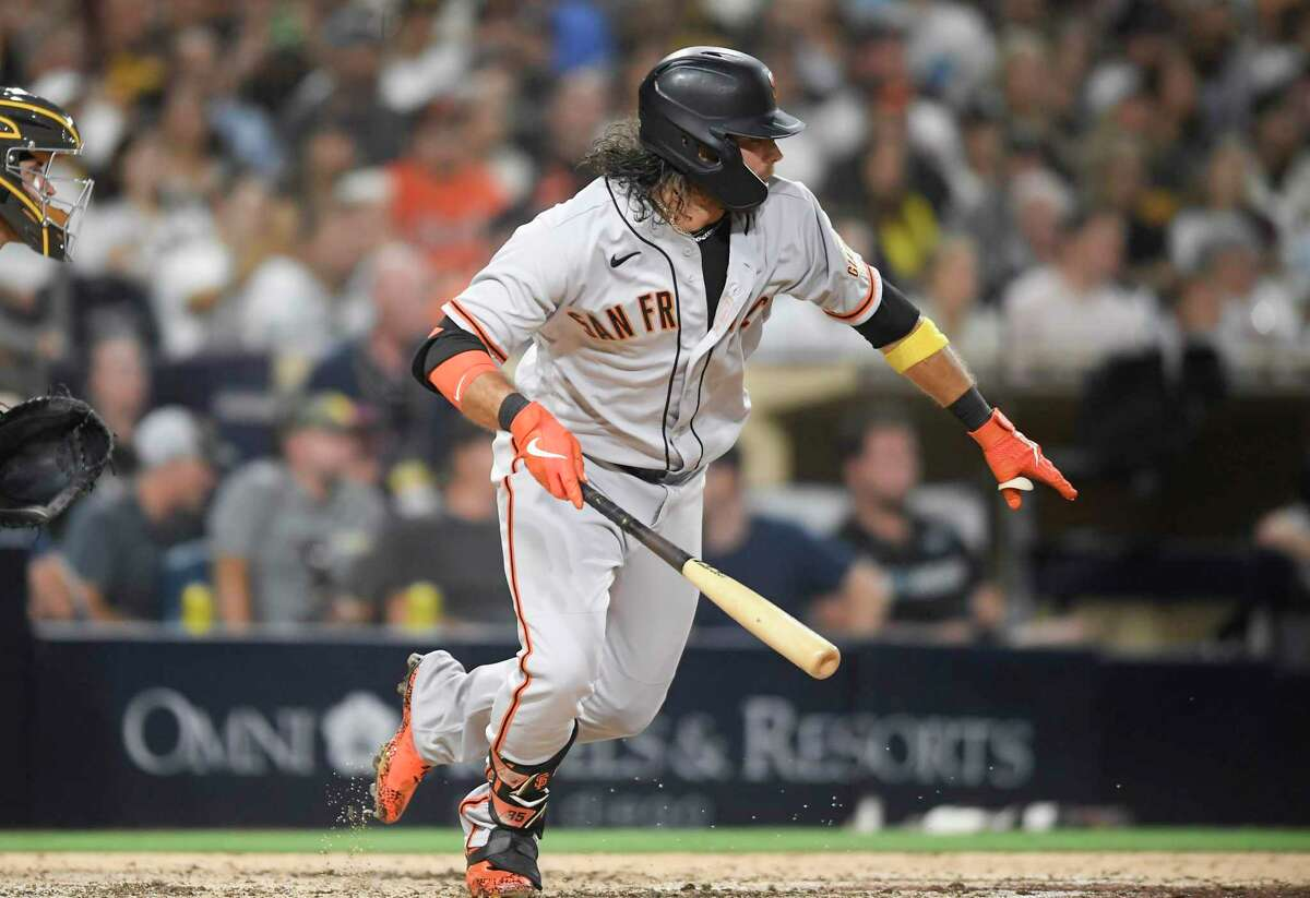 SAN DIEGO, CA - SEPTEMBER 22: Brandon Crawford #35 of the San Francisco Giants hits an RBI single during the sixth inning of a baseball game against the San Diego Padres at Petco Park on September 22, 2021 in San Diego, California. (Photo by Denis Poroy/Getty Images)