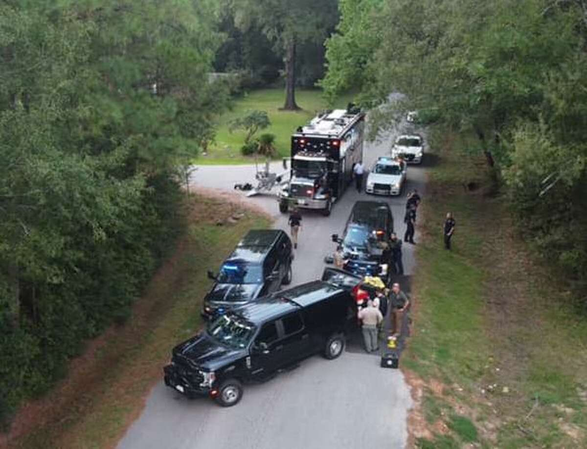 Montgomery County law enforcement and fire response are seen working to secure a device on a side of a road in Conroe. The device was later determined to be a hoax bomb.