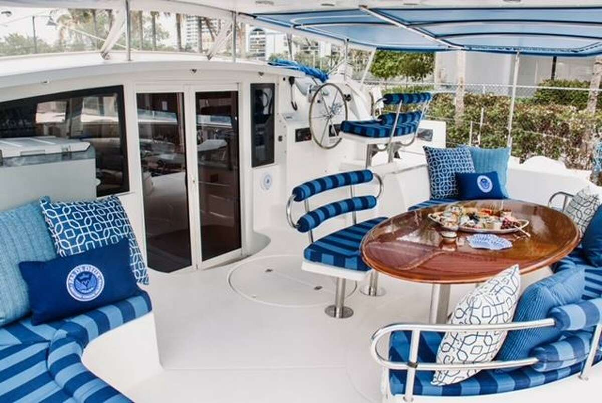 The aft deck of the redecorated boat of Dr. Mike and Bethany McCann. The Houston residents have a summer home in Kemah, where the family enjoys sailing.