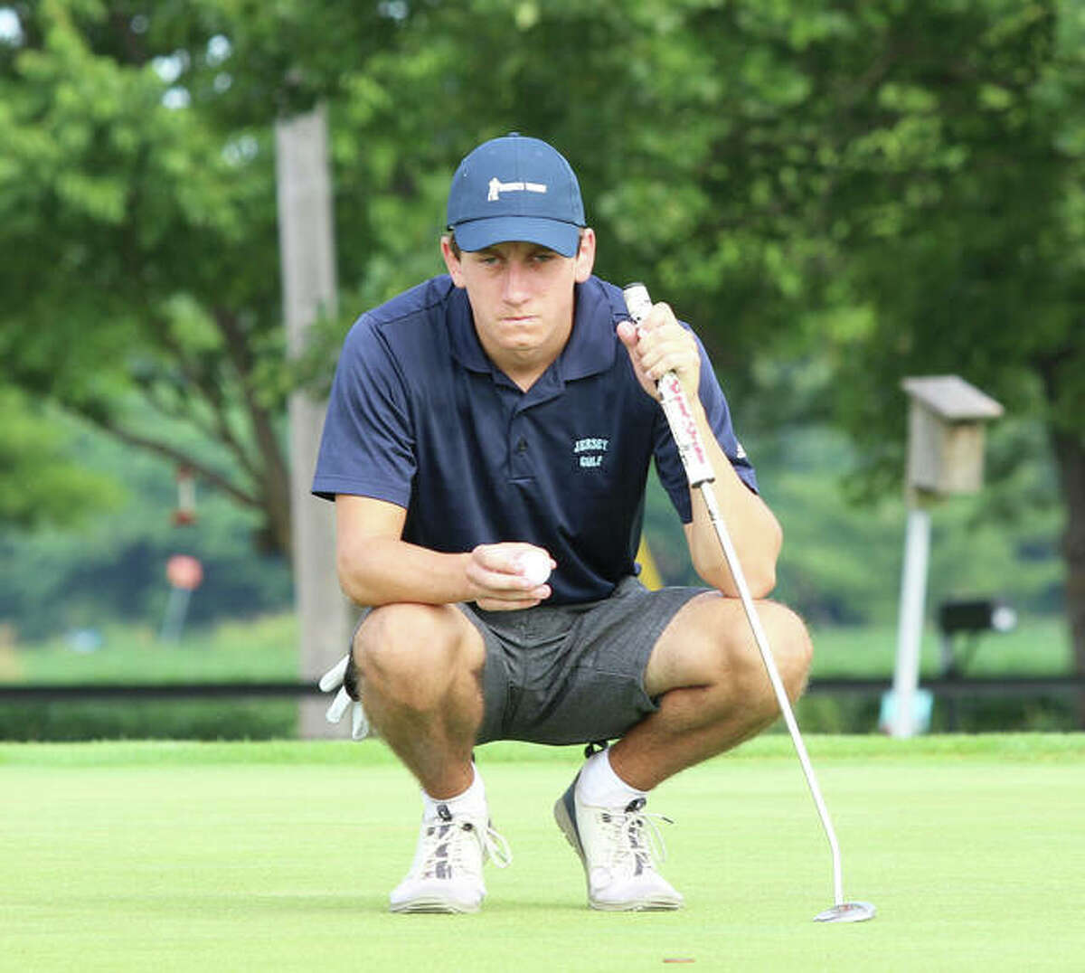 Jersey's Tyler Noble lines up a putt before placing the ball on hole No. 2 at Belk Park in the Hickory Stick Tourney at Aug. 16 in Wood River. Noble was back at Belk for the MVC Tourney on Wednesday and shot 79 to tie teammate Mason Seymour for fourth place.