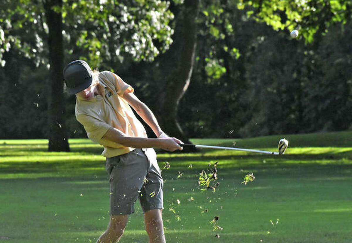 Metro-East Lutheran's Charlie Fedder hits an approach shot during his round on the east nine at Oak Brook Golf Club on Wednesday in Edwardsville.
