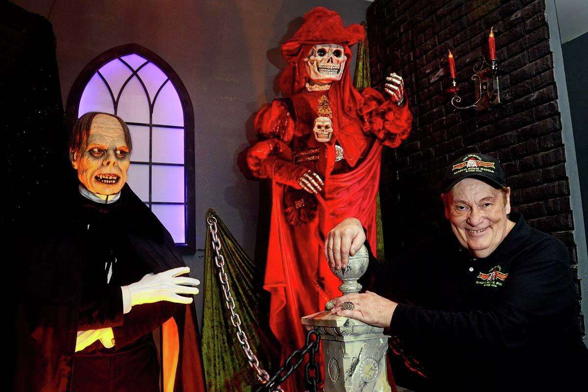 The Witch's Dungeon in Plainville, Conn., if a lifelong labor of love by Cortland Hull, seen here with The Phantom and The Mask of Red Death, two of Lon Chaney's characters from 1925's 'The Phantom of the Opera.'