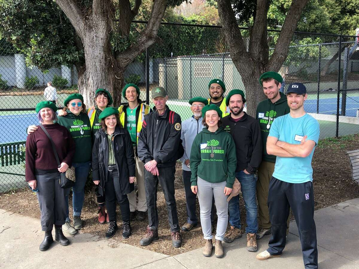 Charlie Starbuck is surrounded by beret-wearing admirers at the last planting he attended for Friends of the Urban Forest in February 2020.