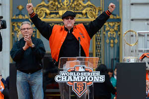 San Francisco Giants broadcast team of Duane Kuiper (L) and Mike Krukow (R) speaks to the fans during the Giants' victory parade and celebration on October 31, 2012