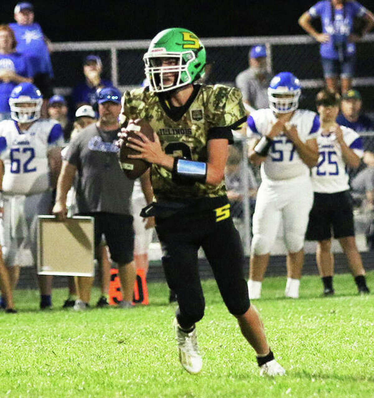 Southwestern QB Quinten Strohbeck looks for a receiver last Friday in the Piasa Birds' win over Greenville at Hauser Field in Piasa.