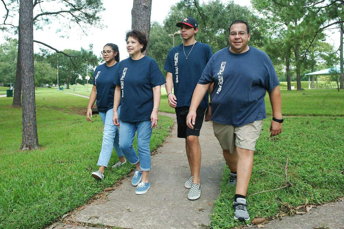 The Sabedra family walks along the trail in Middlebrook Greenbelt Park where they will stage the ninth annual Anita Sabreda Team Hope Walk to support the Huntington's Disease Society of America. From the left are Alyssa and Pat Sabredra, Benjamin Sabredra II and Benjamin Sabedra.
